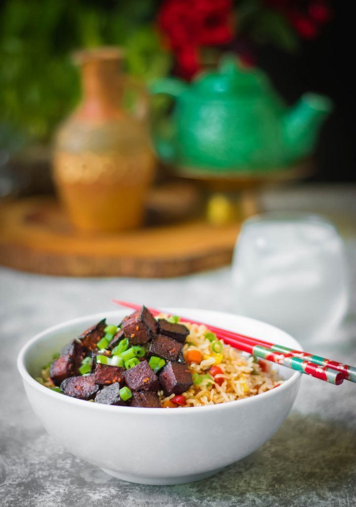 Baked Gochujang Tofu can be a fast + amazing addition to rice bowls, salads & stir-frys without any compromise on loads of flavour!