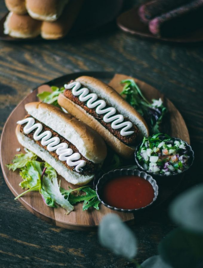 VEGAN Veggie Dogs on a serving board with ketchup and relish on the side
