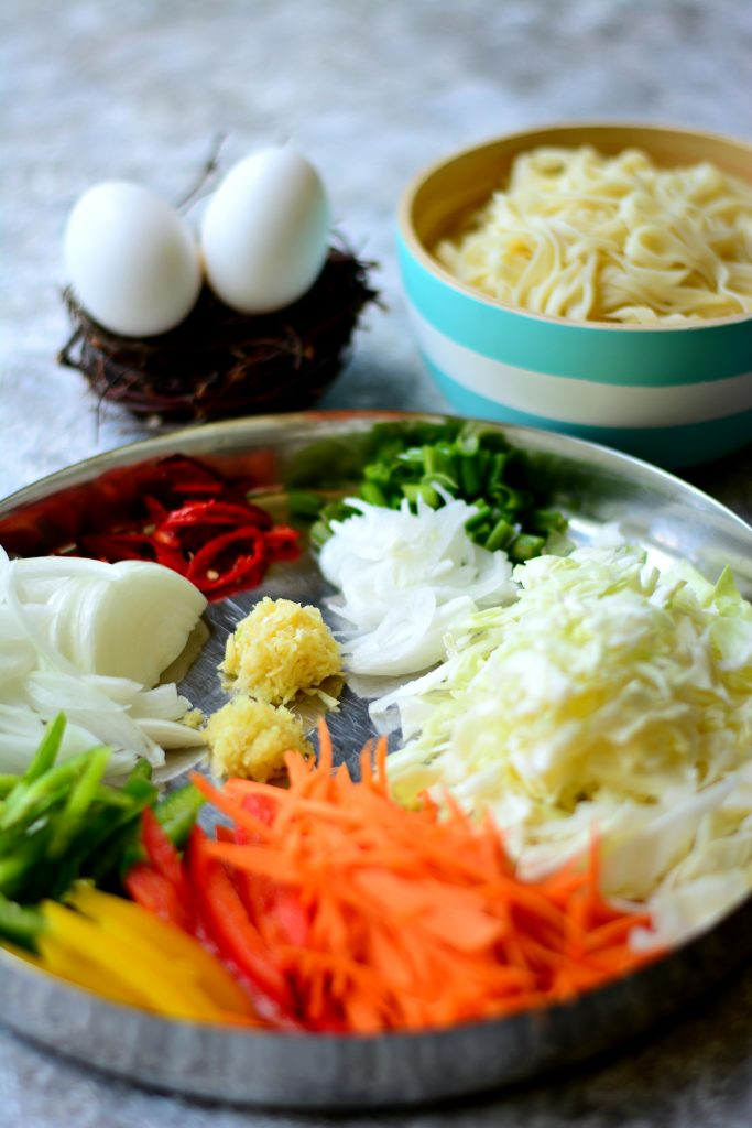 Simple Stir-fried noodles full of vegetables, egg and tons of flavour! Indo-Chinese at it's finest, because this one is homemade!