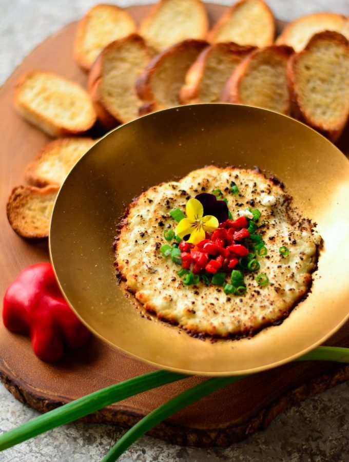 Charred Goat Cheese Queso Fundido with black truffles, honey, red bell peppers and spring onions - the most delicious, exotic dip for two on Valentine's day!