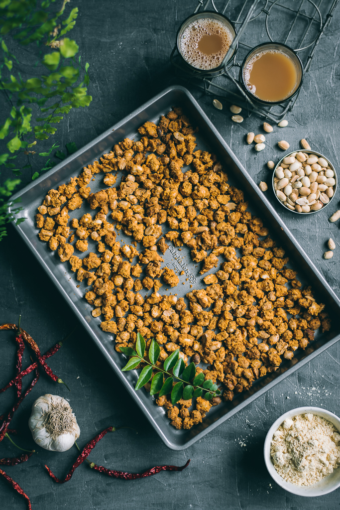 Baked Masala Peanuts coated in a crunchy, savory batter of gluten-free besan flour and spices makes for a wonderful tea time snack!