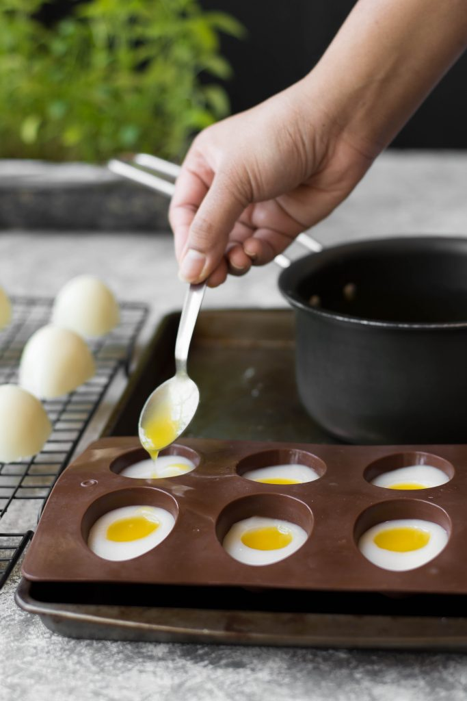 Try this almost Vegan Coconut Mango Jelly Easter 'Egg' made with coconut 'white' & mango yolk complete with a white chocolate shell!