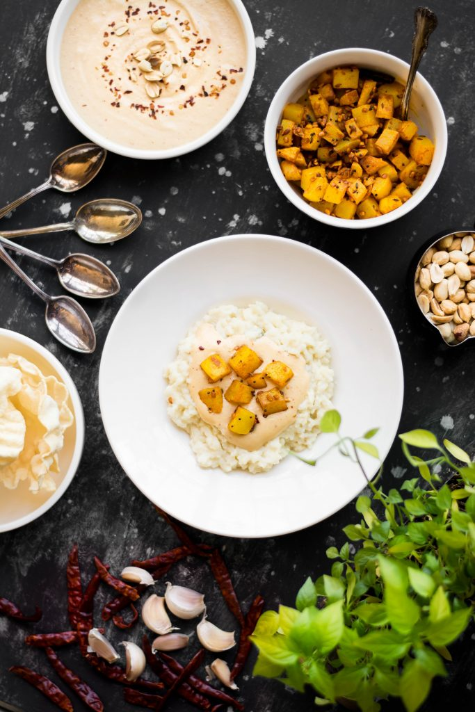 My family makes this Coconut Conjee w/ Peanut Chutney every Good Friday. It's a simple, yet delicious meal that's comfort food at it's best! Vegan + Gluten-free!