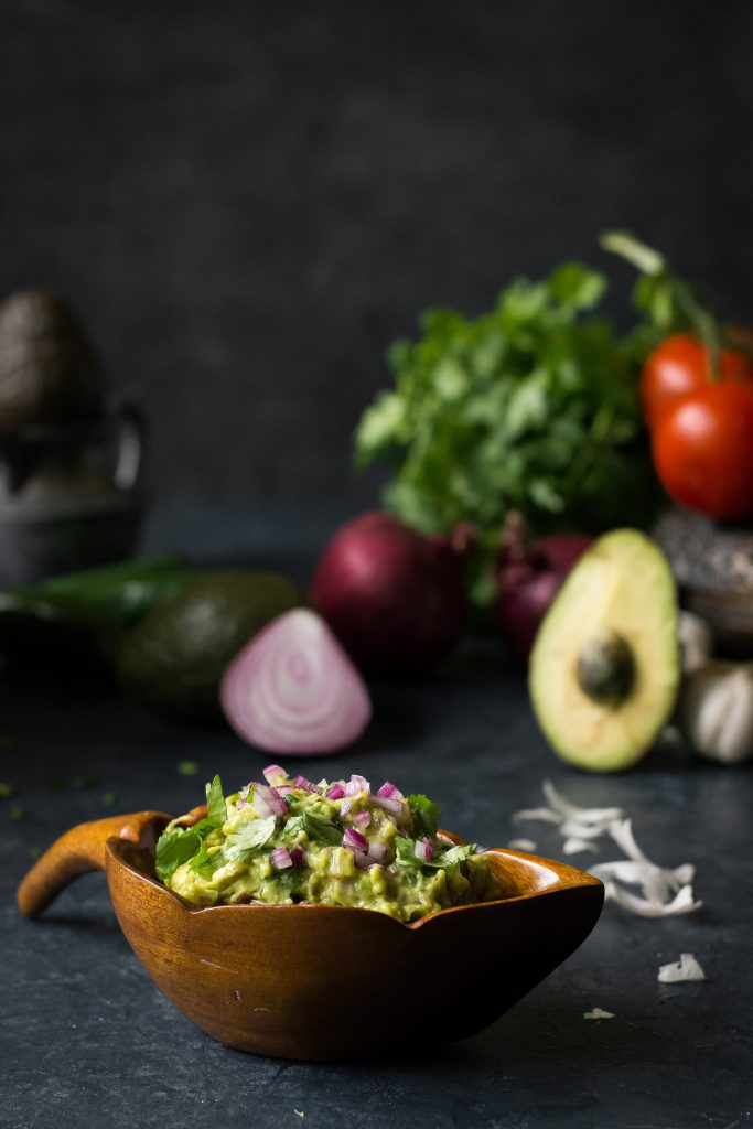 There are so many guacamole recipes out there, but this Spicy Guacamole is my favorite, featuring a Burmese Condiment - fried red chilli flakes! Vegan+Gluten Free! Dips | Appetizers | Snacks