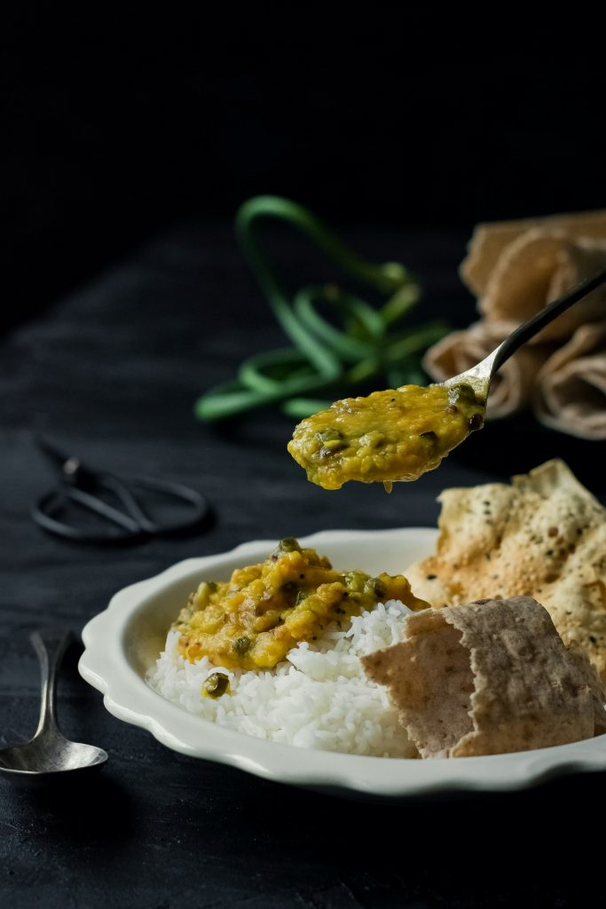 Serve up this delicious + fragrant Garlic Scape Dal (Lentil Curry) with rice, roti or naan for a quick weeknight meal! VEGAN / Gluten-Free!
