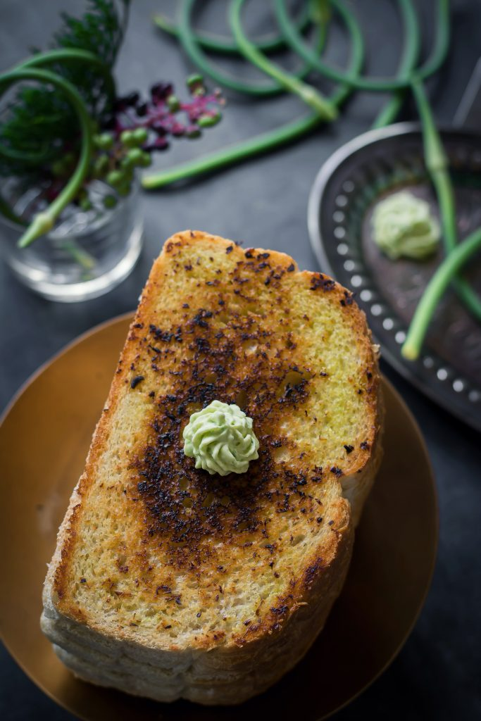 Make the best of scape season with this Vegan Garlic Scape Butter - you can slather it on anything, or use it as a sauté base.