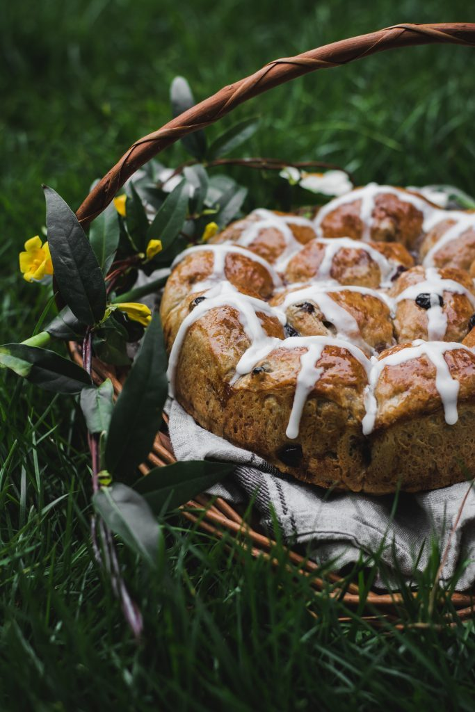VEGAN Hot Cross Buns - a delicious plant-based version of the Good Friday staple - a spiced sweet bread with currants and raisins. #dairyfree #vegan #foodphotography #glazed