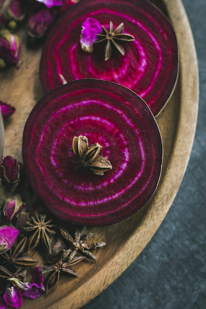 VEGAN Spiced Beet Chai Latte - flavored with Torani Chai Tea Spice Syrup + Rose water, it is a fragrant, soothing drink for Fall! #foodphotography #foodstyling #beets #chailatte #chai #spiced