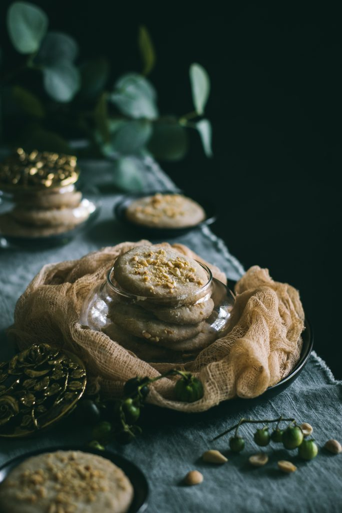 These VEGAN Peanut Shortbread Cookies pair excellently with your evening cup of tea or coffee. #dairyfree #plantbased #foodphotography #foodstyling #darkfoodphotography