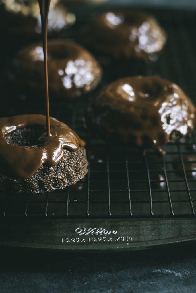 VEGAN Mini Chocolate Hazelnut Bundt Cakes - with a decadent, no-mess, pour-over chocolate icing. #dairyfree