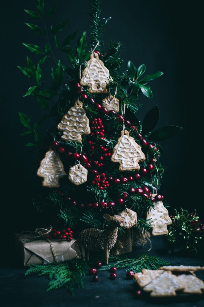 These cinnamon+citrus flavored VEGAN Christmas Tree Ornament Cookies add a beautiful, edible touch to your holiday tree! #vegan #ornamentcookie #eggless #dairyfree #foodphotography #foodstyling