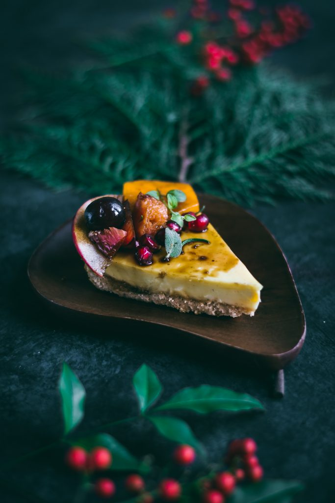 Vegan Custard Pie with a decadent shortbread crust, coconut custard and winter fruits drizzled with sweet balsamic syrup. #foodphotography #foodstyling #veganfood #eggless #dairyfree #custard