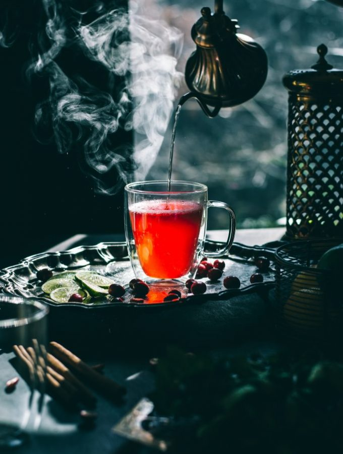 Pouring a Steaming cup of Simple Cranberry Hibiscus Tea from a gooseneck kettle