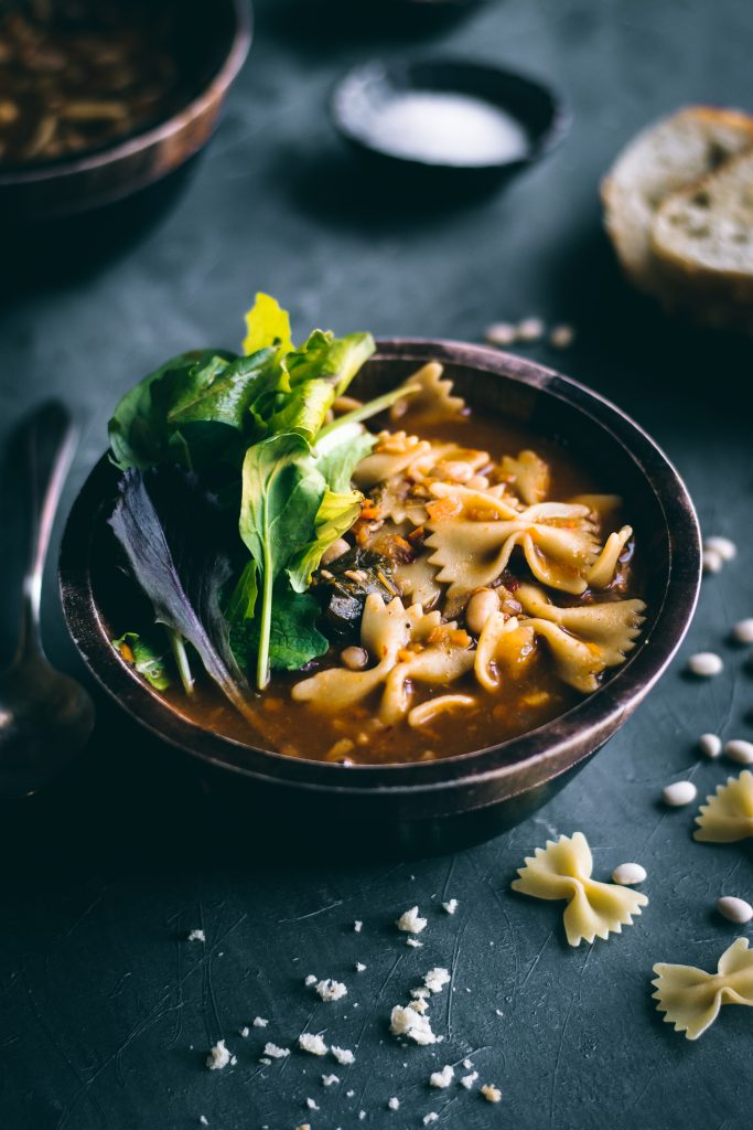 Curried Pasta e Fagioli in a wooden bowl