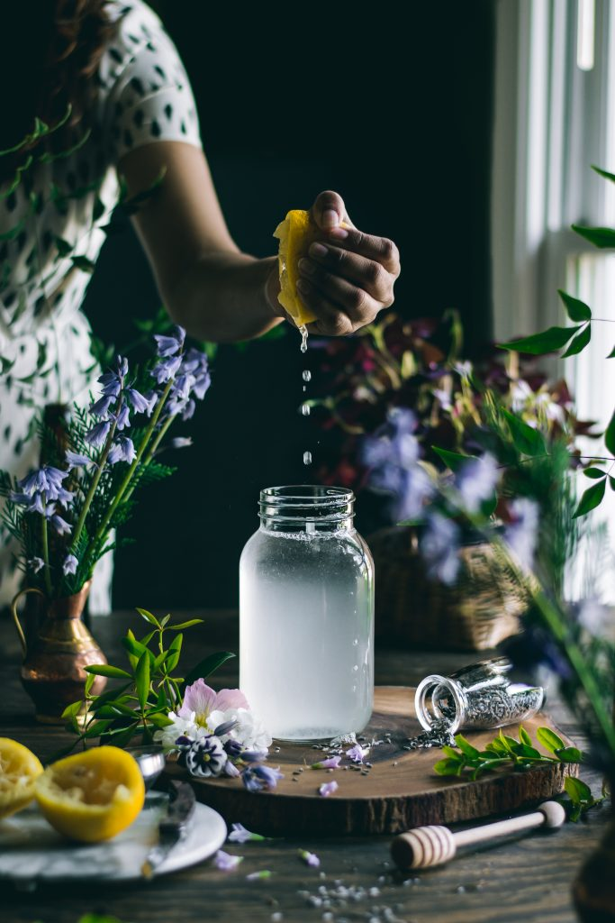 Squeezing lemon for Lavender Lemonade. Every sip of this fragrant, 5 ingredient Lavender Lemonade will remind you of the floral beauty of Spring.