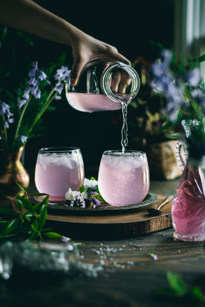Pouring Lavender Lemonade into glasses. Every sip of this fragrant, 5 ingredient Lavender Lemonade will remind you of the floral beauty of Spring.
