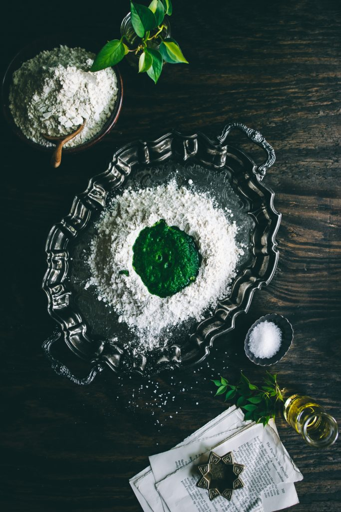 Flour well with spinach puree for making Spinach Roti