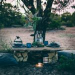 Sunset Tablescape in the remote Utah desert wilderness. Hanging greenery installation centerpiece.