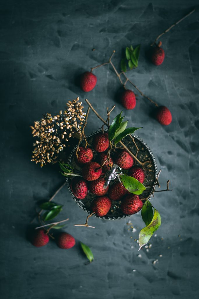 Flatlay of Lychees on a grey background