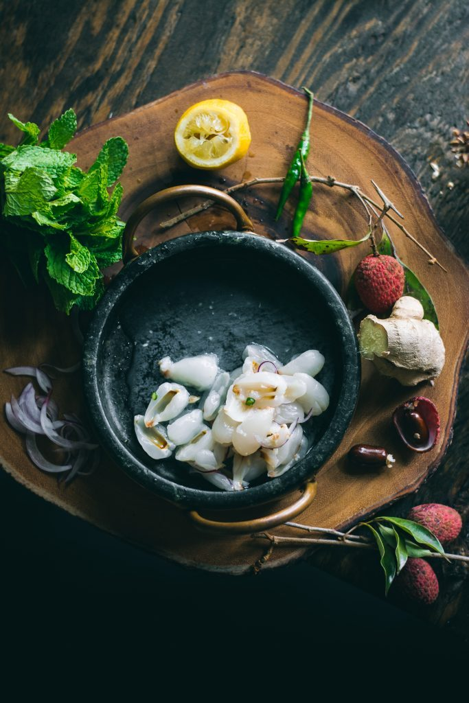 Ingredients for a VEGAN Lychee Ceviche flavored with citrus, green chilli, mint, onions & ginger, it's a delicious plant-based alternative.