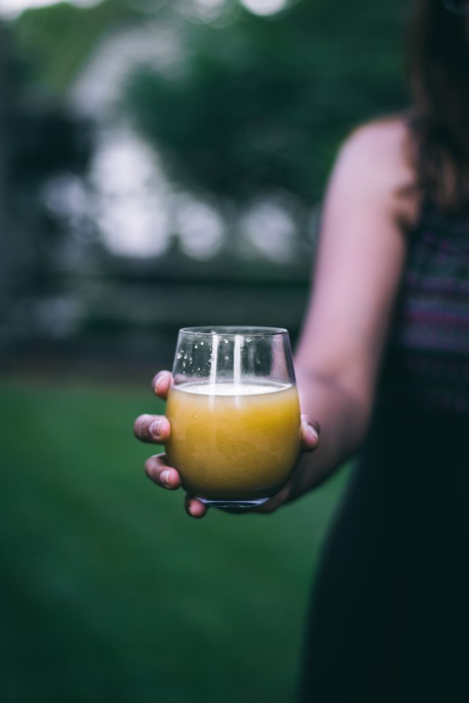 Woman holding glass with juice