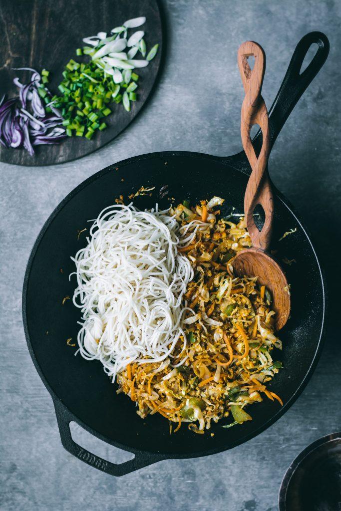 Scrambled Tofu Curry Noodles in a wok