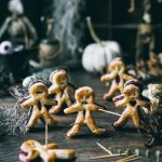 Puff Pastry Voodoo dolls on a table with Halloween things
