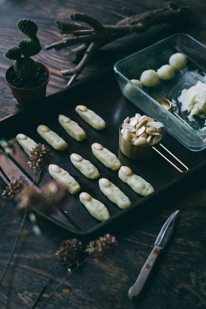 Potato Witch Fingers - a Halloween treat, on a baking tray before it is baked.