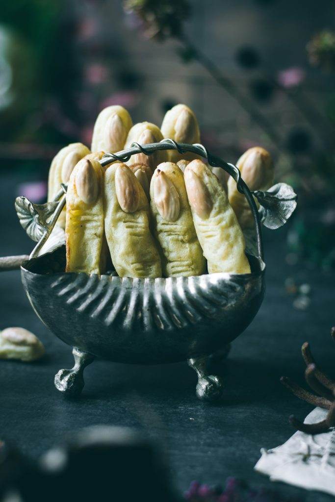Potato Witch Fingers - a Halloween treat sticking outside a metal bowl