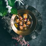 Vegan Gulab Jamun with almond slivers, saffron and cardamom