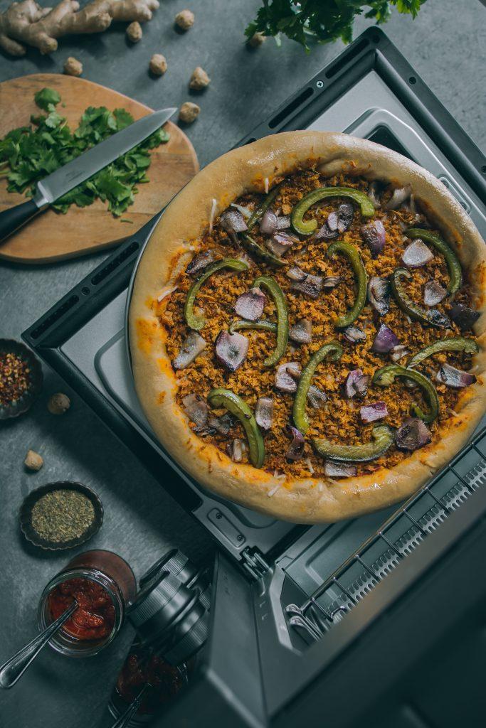 [VEGAN] Minced Meatless Kheema Pizza resting on oven door
