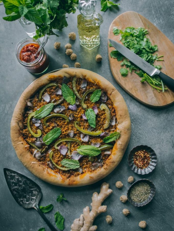 [VEGAN] Minced Meatless Kheema Pizza on tabletop with garnishes