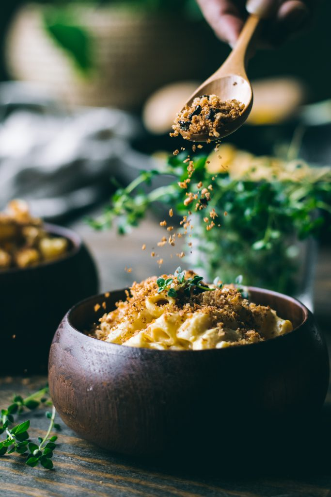 Creamy VEGAN Mac n Cheese on a table with ingredients