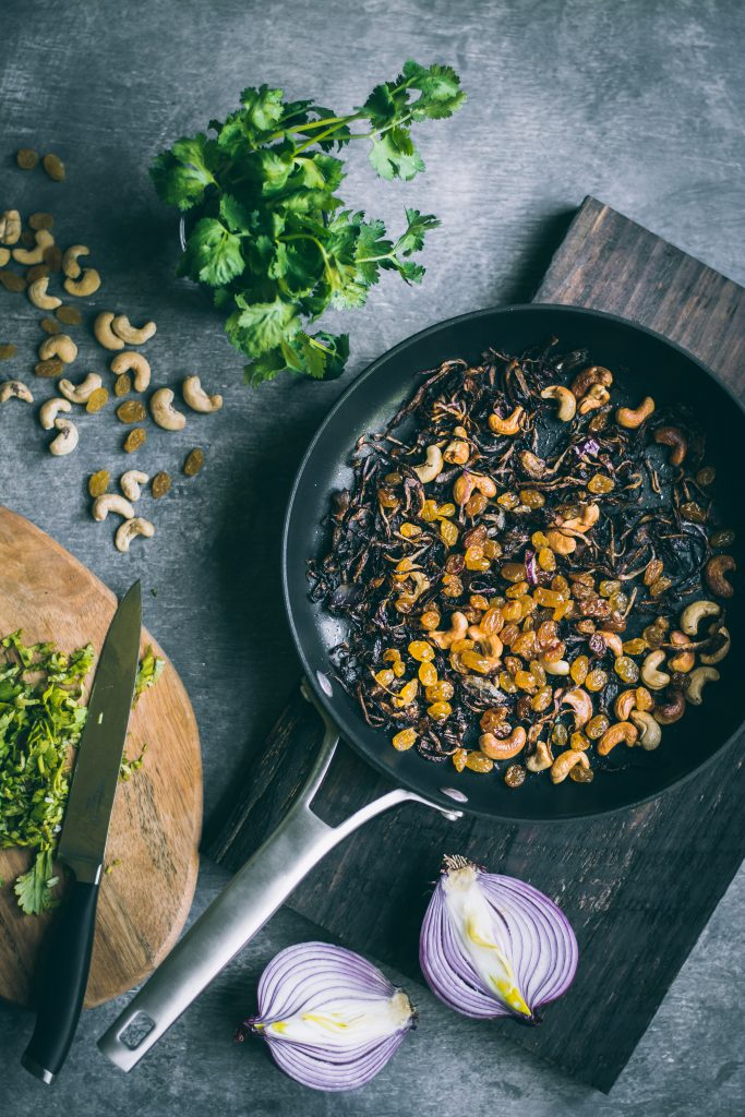 Crispy topping of fried onions, cashews and raisins