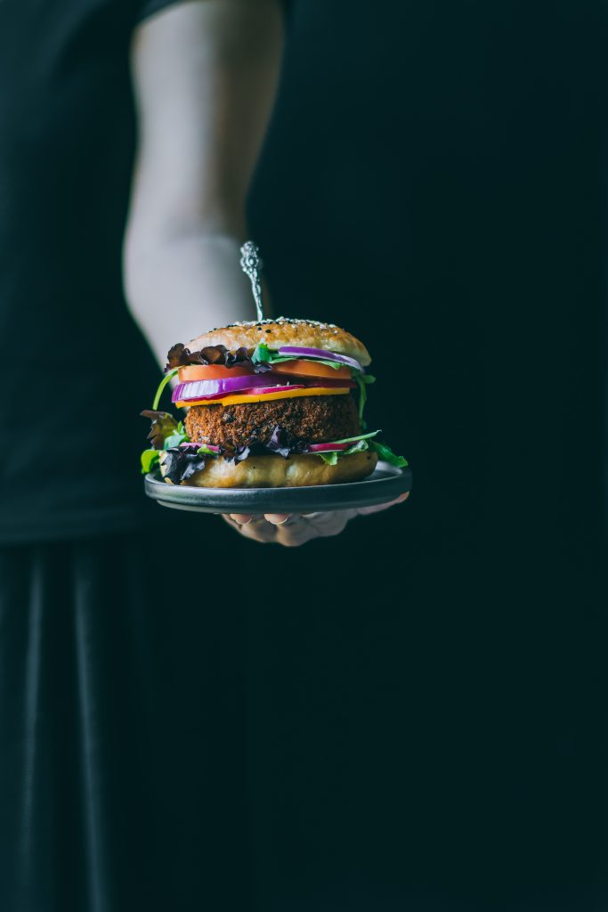 VEGAN Aloo Tikki Burger - with a delicious potato and green pea patty seasoned with spices, crumb coated and deep-fried to a sinfully crisp decadence.