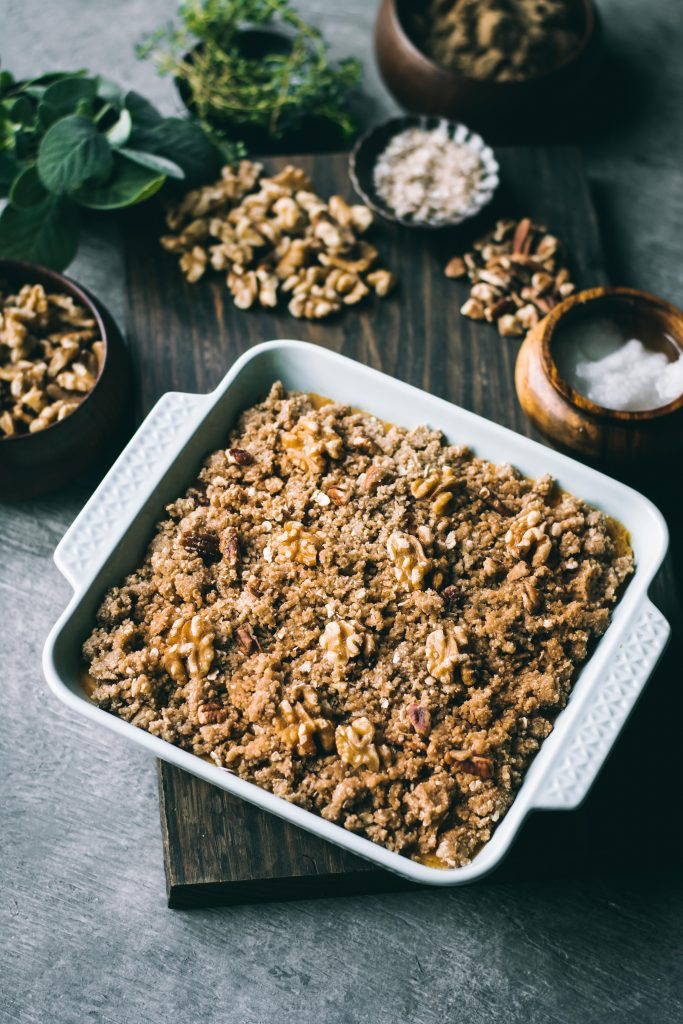 Sweet Potato Casserole with a sweet walnut and pecan topping ready to be baked