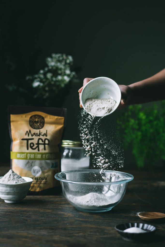 Making batter for Teff Roti Jala