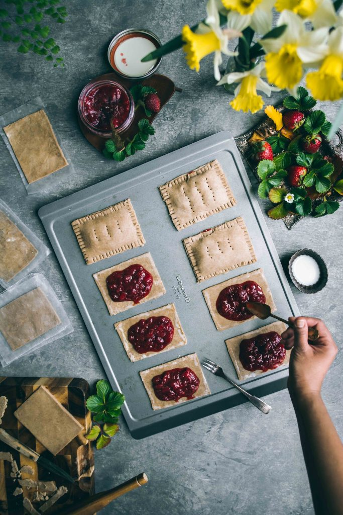 Filling Teff Strawberry Pop Tarts with a homemade strawberry jam